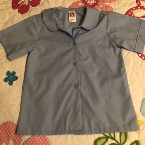 2 Light blue collared button up tops.